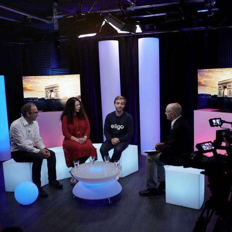 Filming studio with live talk show TV set with backlit LEDs in Paris - Videology Studio